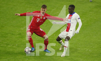 07/04/2021 - Joshua Kimmich of Bayern Munich and Idrissa Gueye of Paris Saint-Germain during the UEFA Champions League, quarter final, 1st leg football match between Bayern Munich and Paris Saint-Germain on April 7, 2021 at Allianz Arena in Munich, Germany - Photo Marcel Engelbrecht / firo Sportphoto / DPPI - BAYERN MUNICH VS PARIS SAINT-GERMAIN - UEFA CHAMPIONS LEAGUE - CALCIO