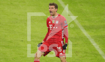07/04/2021 - Thomas Mueller of Bayern Munich celebrates after his goal 2-2 during the UEFA Champions League, quarter final, 1st leg football match between Bayern Munich and Paris Saint-Germain on April 7, 2021 at Allianz Arena in Munich, Germany - Photo Marcel Engelbrecht / firo Sportphoto / DPPI - BAYERN MUNICH VS PARIS SAINT-GERMAIN - UEFA CHAMPIONS LEAGUE - CALCIO