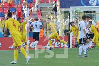 27/06/2019 - Romania´s George Puscas celebrates after scoring the goal on penalty for 1 - 1  - UEFA EUROPEAN UNDER-21 CHAMPIONSHIP 2019 - SEMIFINALS MATCH BETWEEN GERMANY AND ROMANIA - INTERNAZIONALI - CALCIO