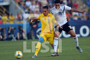 27/06/2019 - Cristian Marian Manea of Romania in action against Nadiem Amiri of Germany - UEFA EUROPEAN UNDER-21 CHAMPIONSHIP 2019 - SEMIFINALS MATCH BETWEEN GERMANY AND ROMANIA - INTERNAZIONALI - CALCIO