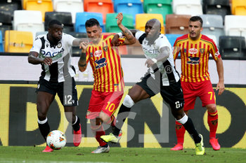 29/07/2020 - Lecce's Filippo Falco (C) contrasted by Udinese's Ken Sema and Seko Fofana (R) during the Italian Serie A soccer match Udinese Calcio vs US Lecce at the Friuli - Dacia Arena stadium in Udine, Italy, 29 July 2020. ANSA/GABRIELE MENIS - UDINESE VS LECCE - SERIE A - CALCIO