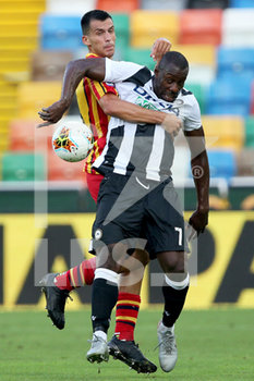 29/07/2020 - Udinese's Stefano Okaka (R) and Lecce's Mario Paz in action during the Italian Serie A soccer match Udinese Calcio vs US Lecce at the Friuli - Dacia Arena stadium in Udine, Italy, 29 July 2020. ANSA/GABRIELE MENIS - UDINESE VS LECCE - SERIE A - CALCIO