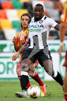 29/07/2020 - Udinese's Stefano Okaka (R) and Lecce's Jacopo Petriccione in action during the Italian Serie A soccer match Udinese Calcio vs US Lecce at the Friuli - Dacia Arena stadium in Udine, Italy, 29 July 2020. ANSA/GABRIELE MENIS - UDINESE VS LECCE - SERIE A - CALCIO
