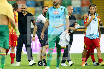 29/07/2020 - Lecce's players and coach Fabio Liverani celebrate for the victory at the end of the Italian Serie A soccer match Udinese Calcio vs US Lecce at the Friuli - Dacia Arena stadium in Udine, Italy, 29 July 2020. ANSA/GABRIELE MENIS - UDINESE VS LECCE - SERIE A - CALCIO