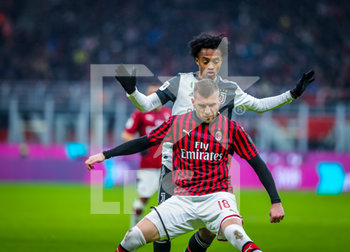 13/02/2020 - Ante Rebic of AC Milan and Juan Cuadrado of Juventus during the Coppa Italia 2019/20 match between AC Milan vs Juventus at the San Siro Stadium, Milan, Italy on February 13, 2020 - Photo Fabrizio Carabelli - MILAN VS JUVENTUS -  - CALCIO