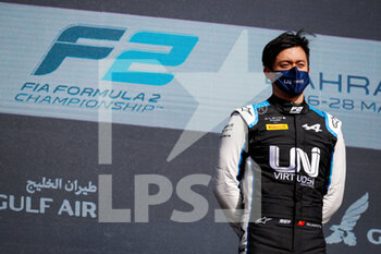 28/03/2021 - Zhou Guanyu (chn), UNI-Virtuosi Racing, Dallara F2, portrait win celebration podium during the 1st round of the 2021 FIA Formula 2 Championship from March 26 to 28, 2021 on the Bahrain International Circuit, in Sakhir, Bahrain - Photo Florent Gooden / DPPI - 1ST ROUND OF THE 2021 FIA FORMULA 2 CHAMPIONSHIP - FORMULA 2 - MOTORI